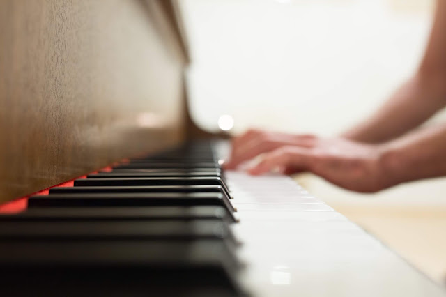 Canva - Person Playing Piano